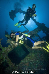 Divers cheking out Nippo Maru-Truk Lagoon by Richard Goluch 